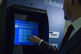 representatives-of-a-bitcoin-kiosk-company-demonstrate-the-currency-product-on-capitol-hill.jpg