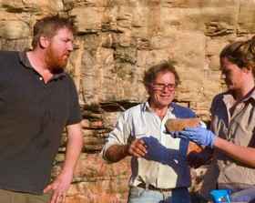 A-supplied-image-shows-Chris-Clarkson-Richard-Fullagar-and-Elspeth-Hayes-examining-a-rare-grindston.jpg