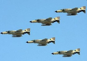 Iranian fighter jets fly across Iran's western airspace