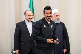 The Iranian player Reza Ghouchan Nezhad was honoured by Mr Rouhani. / The members of Iran national football team and coaching staff met with the Iranian President Hassan Rouhani on Sunday May 20 in Tehran.