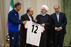 The number 12 Iran's football kit was presented to Hassan Rouhani during the ceremony.The members of Iran national football team and coaching staff met with the Iranian President Hassan Rouhani on Sunday May 20 in Tehran.