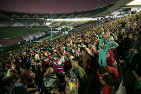 Iranian families watched the World Cup match between Iran and Spain at Azadi Stadium.