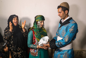 Giving white flowers to bride as a sign of friendship / Although modern life has impacted on traditional customs especially on weddings, there are some families in Lorestan province who follow these customs.