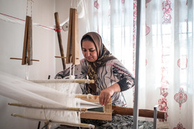 Ameneh, 40, earns money by weaving silk. She hopes that her job will be better with the development of tourism industry in Golestan province.