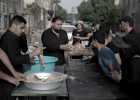 People who live in Najaf City provide food for Imam Hussain's pilgrims.
