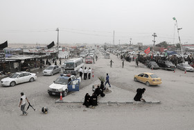 Iraqis live their daily life despite the lack of appropriate facilities in their cities.