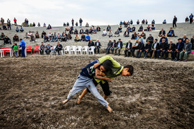 Tous City of Razavi Khorasan province / According to a tradition, children compete against each other before the main Chukhe wrestling competition.