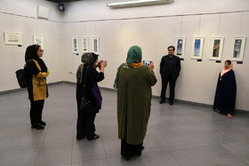 Sheyda Shokravi (R), a professional painter who was born with no arms, is seen in her gallery while photographers take her photos, December 3, 2018.