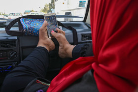 Sheyda Shokravi, who was born with no arms, uses a mobile phone with her feet, December 3, 2018.