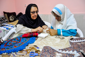 A woman learns how to embroider, the Rehabilitation Centre of Ali Akbar, Birjand City, December 3, 2018.