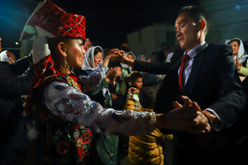 The bride and groom dance together, Iran, Bandar Torkaman City, December 8, 2018.
