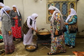 The bride's family prepare food as the bride is going to the groom's house, Iran, Bandar Torkaman City, December 8, 2018.