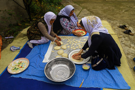 Kazakh women make breads for the wedding ceremony, Iran, Bandar Torkaman City, December 8, 2018.