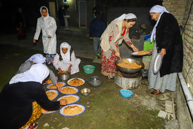 The family of the bride's uncle prepare dinner as they invited bride and groom to dinner, Iran, Bandar Torkaman City, December 8, 2018.