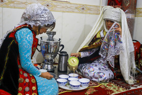The bride serves cups of tea and milk for the groom's family in accordance with an old custom, Iran, Bandar Torkaman City, December 8, 2018.