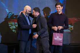 Iranian actor Navid Mohammad Zadeh (M) was awarded a prize in the twelfth Celebration of Iran's Film Critics and Writers, Tehran, Eyvan-e Shams Hall, December 18, 2018.