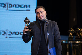Iranian actor Navid Mohammad Zadeh was awarded a prize in the twelfth Celebration of Iran's Film Critics and Writers, Tehran, Eyvan-e Shams Hall, December 18, 2018.