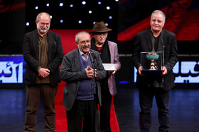 Iranian graphic designer Ebrahim Haghighi, delivering speech, is honoured during the opening ceremony of the 37th Fajr Film Festival, Iran, Tehran, January 29.