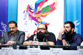 Iranian actor Reza Akhlaghi Rad (R) and the director of 'The Blood of God' Morteza Ali Abbas Mirzaei (M) are present on the fifth day of the 37th Fajr Film Festival, Iran, Tehran, February 3, 2019.