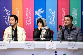 """Iranian actors Hamid Reza Pegah (R) and Mahdi Zamin Pardaz and Iranian actress Linda Kiani are present in the press conference of the Fajr Film Festival, Iran, Tehran, February 5. They are the members of the casts of """"Watching This Movie is a Crime""""."""