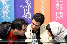 """Iranian director Reza Zahtabchian (L), Iranian actor Mahdi Zamin Pardaz and Iranian actress Linda Kiani are present on the 7th day of the Fajr Film Festival, Iran, Tehran, February 5. They are the members of the casts of """"Watching This Movie is a Crime""""."""