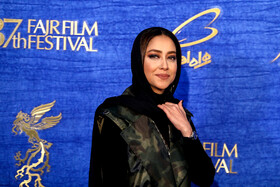 """Iranian actress Bahareh Kian Afshar is present on the 7th day of the Fajr Film Festival, Iran, Tehran, February 5. She is one of the members of the cast of """"Polo Coat""""."""