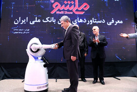 Managing Director of Bank Melli Iran Mohammad Reza Hosseinzadeh are present in unveiling ceremony of Iran's new banking products in 'Melli Show 2' event, Iran, Tehran, February 24, 2019.