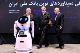 Minister of Economic Affairs and Finance Farhad Dejpasand (R), Deputy Speaker Masoud Pezeshkian (M) and Managing Director of Bank Melli Iran Mohammad Reza Hosseinzadeh are present during unveiling ceremony of Iran's new banking products in 'Melli Show 2' event, Iran, Tehran, February 24, 2019.