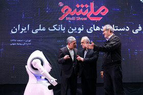 Minister of Economic Affairs and Finance Farhad Dejpasand (M), Deputy Speaker Masoud Pezeshkian (R) and Managing Director of Bank Melli Iran Mohammad Reza Hosseinzadeh are present during unveiling ceremony of Iran's new banking products in 'Melli Show 2' event, Iran, Tehran, February 24, 2019.