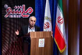 Minister of Economic Affairs and Finance Farhad Dejpasand delivers a speech during unveiling ceremony of Iran's new banking products in 'Melli Show 2' event, Iran, Tehran, February 24, 2019.