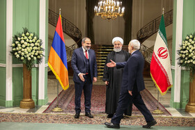 Iranian Foreign Minister Mohammad Javad Zarif (R), Iranian President Hassan Rouhani (M) are present during welcoming ceremony for Armenian PM (L), Iran, Tehran, February 27, 2019.