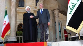 President Rouhani officially welcomed by Iraqi counterpart