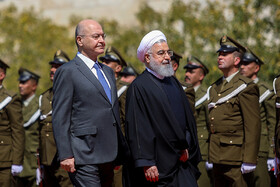 Iranian President Hassan Rouhani (R) is welcomed by his Iraqi counterpart Barham Salih, Iraq, Baghdad, March 11, 2019.
