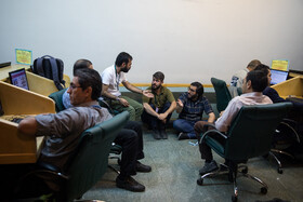 Photographers and correspondents wait for the end of closed-door session of Iran's Parliament, Tehran, Iran, May 12, 2019.