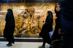 """Tableau of """"Battle of Rostam and dragon"""" is seen at a Metro Station in Mashhad, Iran, May 15, 2019. Rostam is a great Iranian hero in Shahnameh."""
