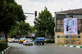 """A banner on which Ferdowsi is shown, Mashhad, Iran, May 15, 2019. Ferdowsi was a great Persian Poet who wrote one of the most important Iranian literary works, """"Shahnameh"""" meaning """"The book of kings""""."""