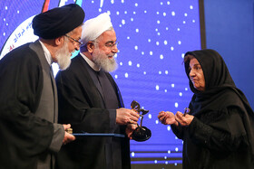 Some of martyrs' families are honoured by Iranian President Hassan Rouhani at the 12th National Conference for Praising War Veterans, Tehran, Iran, May 23.