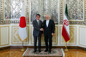 Japanese Foreign Minister Taro Kono (L) is welcomed by Iranian Foreign Minister Mohammad Javad Zarif, Tehran, Iran, June 12, 2019.