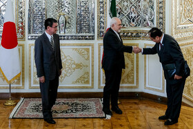 A Japanese official, who has accompanied Japanese Foreign Minister Taro Kono (L) to Tehran, is welcomed by Iranian Foreign Minister Mohammad Javad Zarif (M),  Tehran, Iran, June 12, 2019.