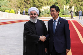 Japanese Prime Minister Shinzo Abe (R) is officially welcomed by Iranian President Hassan Rouhani at Sa'dabad Cultural-Historical Complex, Tehran, Iran, June 12, 2019.