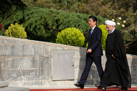 Japanese Prime Minister Shinzo Abe (L) is officially welcomed by Iranian President Hassan Rouhani at Sa'dabad Cultural-Historical Complex, Tehran, Iran, June 12, 2019.