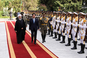 Japanese Prime Minister Shinzo Abe (M) is officially welcomed by Iranian President Hassan Rouhani at Sa'dabad Cultural-Historical Complex, Tehran, Iran, June 12, 2019.