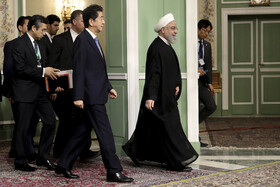 On the sidelines of the joint press conference between Iranian President Hassan Rouhani (R) and Japanese Prime Minister Shinzo Abe, Tehran, Iran, June 12, 2019.
