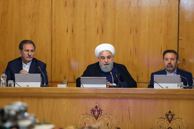 """Iranian President Hassan Rouhani (M), Iran's First-Vice President Es'haq Jahangiri (L) and Iranian President's Chief of Staff Mahmoud Vaezi are present at Iran's weekly cabinet session, Tehran, Iran, June 19, 2019. Speaking in a cabinet session on Wednesday, Dr Hassan Rouhani said, """"The United States' actions against the Iranian nation is not sanction, but economic terrorism and crime against humanity""""."""