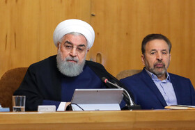 """Iranian President Hassan Rouhani (L) and Iranian President's Chief of Staff Mahmoud Vaezi are present at Iran's weekly cabinet session, Tehran, Iran, June 19, 2019. Speaking in a cabinet session on Wednesday, Dr Hassan Rouhani said, """"The United States' actions against the Iranian nation is not sanction, but economic terrorism and crime against humanity""""."""