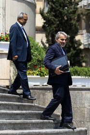 Head of Iran's Planning and Budget Organization Mohammad Baqer Nobakht (R) is seen on the sidelines of Iran's weekly cabinet session, Tehran, Iran, June 19, 2019.