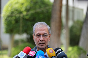 """Spokesman of Iranian government Ali Rabiei is answers the questions of the correspondents on the sidelines of Iran's weekly cabinet session, Tehran, Iran, June 19, 2019. Speaking in a cabinet session on Wednesday, Dr Hassan Rouhani said, """"The United States' actions against the Iranian nation is not sanction, but economic terrorism and crime against humanity""""."""