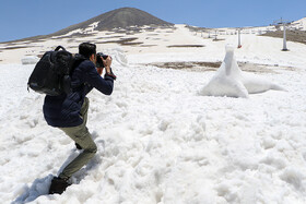 2nd snowman festival in Tochal Ski Resort, Tehran, Iran, June 21, 2019. During the festival people made some interesting snow figures.