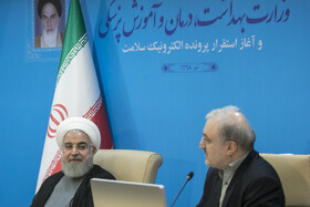 """Iranian President Hassan Rouhani (L) is seen in his meeting with top officials working under Ministry of Health and Medical Education including Iranian Minister of Health and Medical Education Saeed Namaki (R), Tehran, Iran, June 25, 2019. During this meeting President Hassan Rouhani said, """"All doctors, nurses and health centres have had a role in the big project of Healthcare Reform Plan""""."""