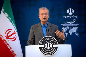 """Iranian government's spokesman Ali Rabiei answers the questions of correspondents on the sidelines of Iran's weekly cabinet session, Tehran, Iran, June 26, 2019. Speaking on Wednesday at Iran's weekly cabinet session, Mr Rouhani congratulated national week of Iran's Judiciary and said, """"The way to reach security, freedom, welfare and Iran's honour is following the path of Islam, Imam Ali (PBUH), Imam Khomeini and Doctor Beheshti and all of us should put in extra effort for serving people""""."""